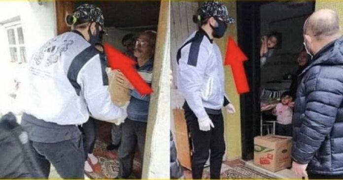 Fakirlere erzak dağıtırken yüzünü gizleyen futbolcu..